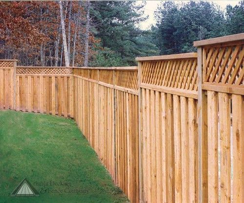 Shadowbox Fence With 12in Lattice Top This Fence Stairsteps With The Land Designed And Built By Atlanta Dec Fence Landscaping Shadow Box Fence Fence Planters