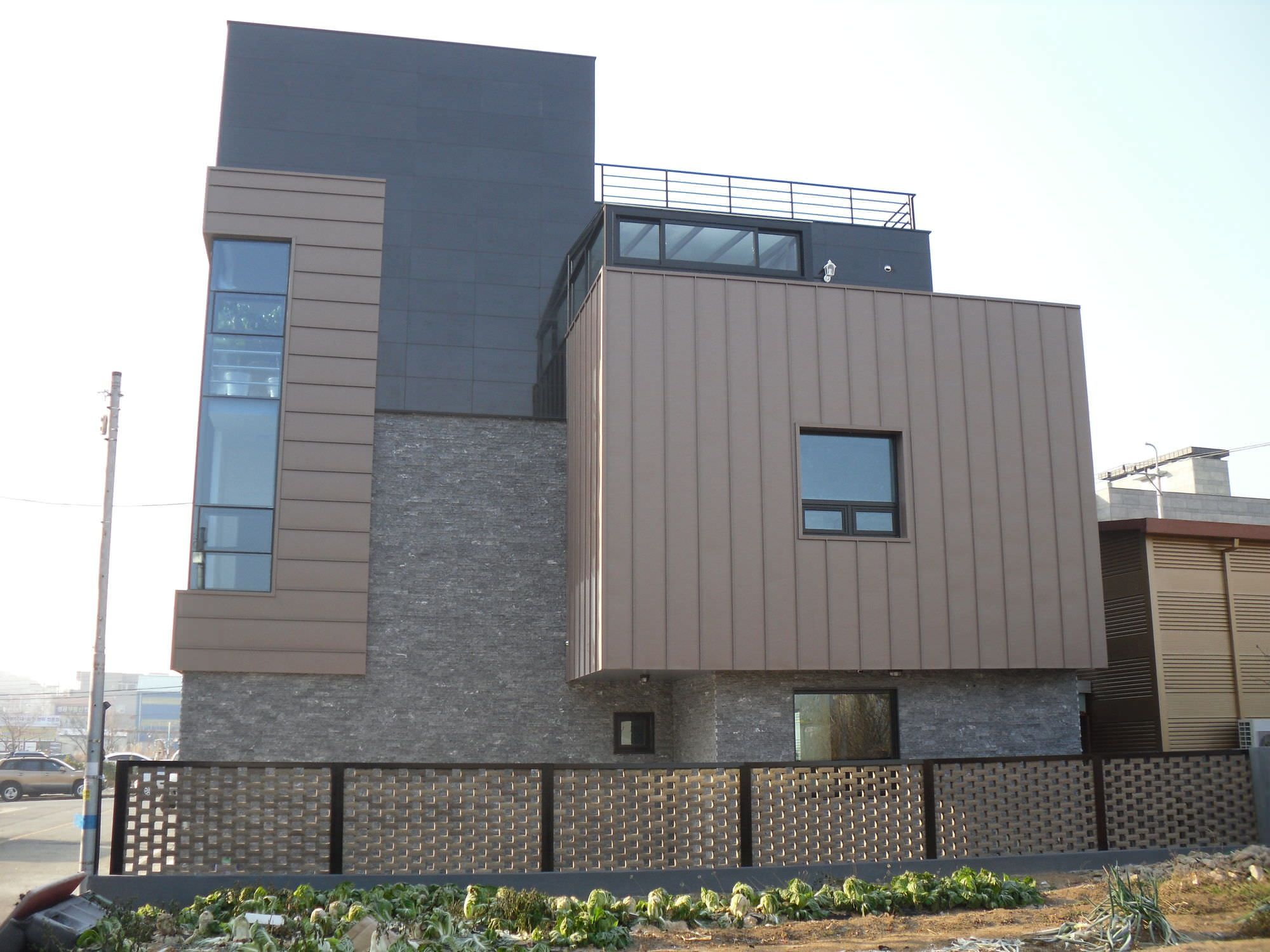 Image result for stone faced houses with brown zinc roofs for Architecture zinc