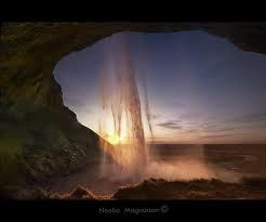 Beautimus Sunset with water falling in front of it <3