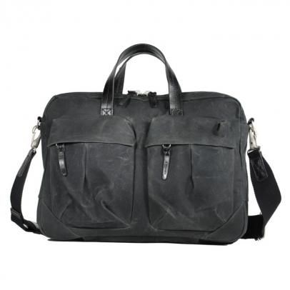 """tommy work bag (coal) is a bag out of waxed cotton and strong leather from """"property of.."""" a young label from Singapoure (€ 188,- instead of 228,-)"""