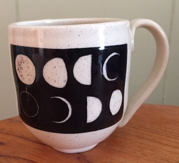 This listing is for one handmade, ceramic stoneware mug with the phases of the moon carved in it. Cozy up with your coffee or tea while