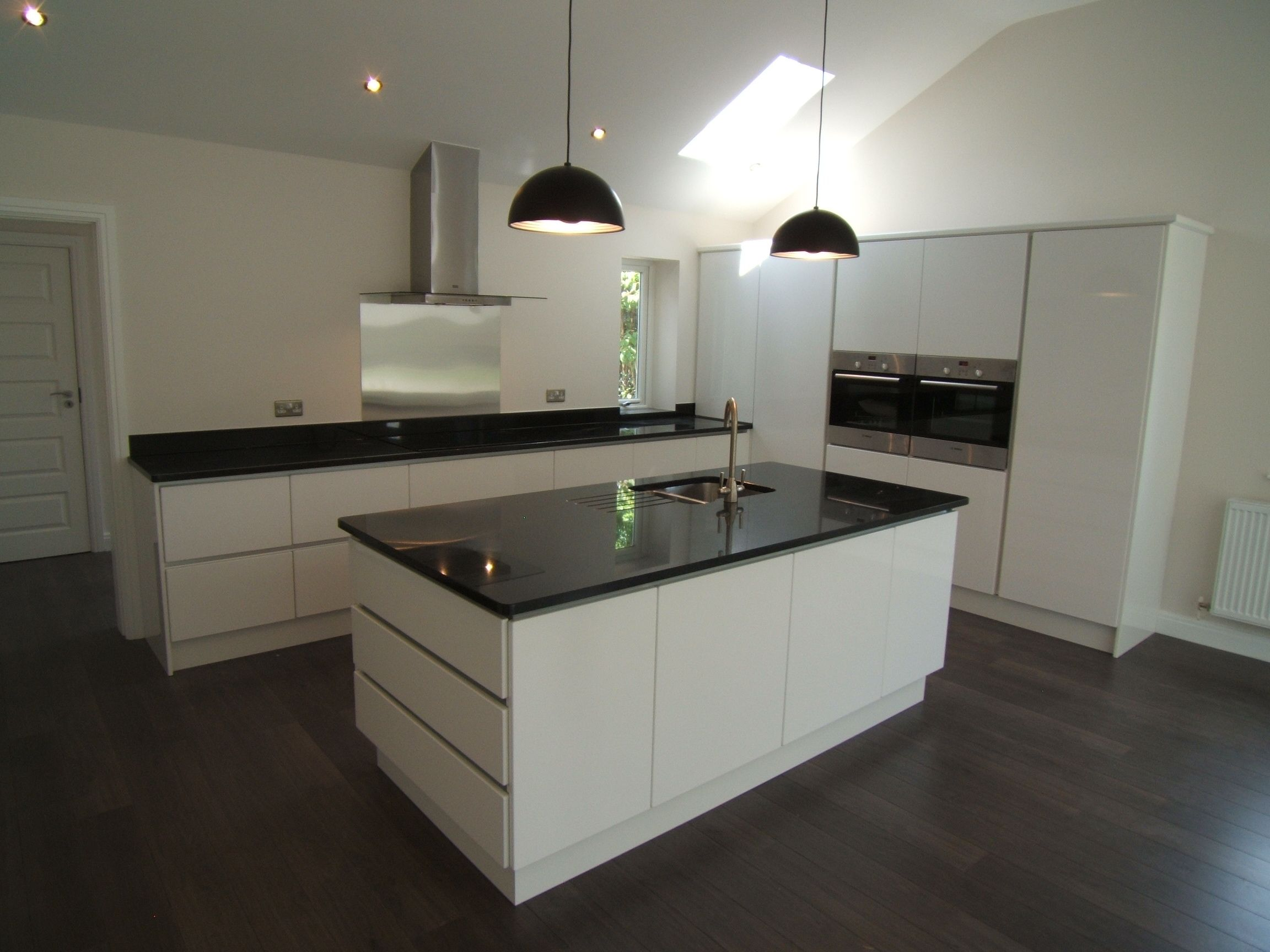 White Kitchen Units Black Worktop nerosupreme #granite on contemporary white handless kitchen units