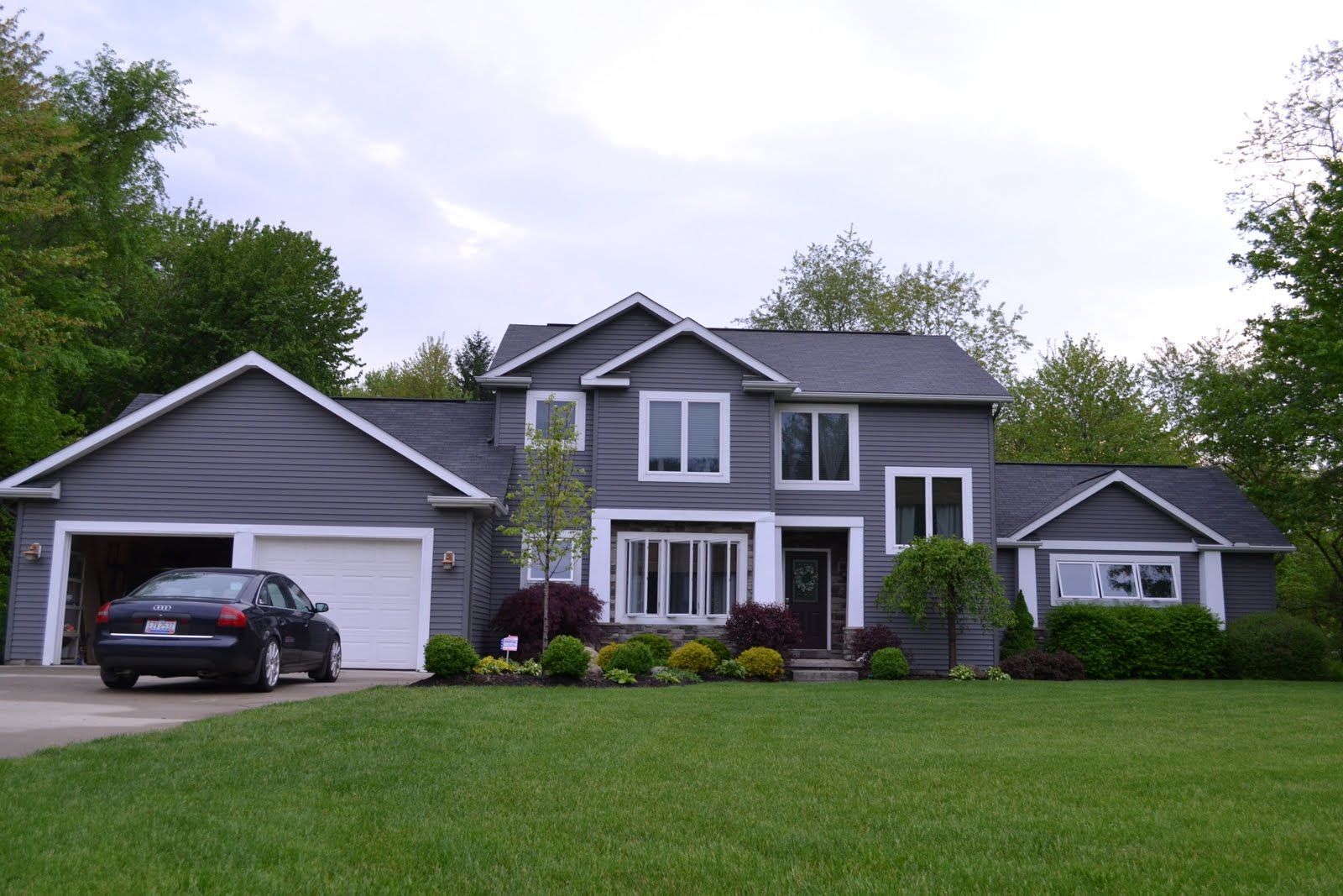 Grey houses with black trim back to this gray house it s a gorgeous dark gray and with the - Exterior paint grey image ...