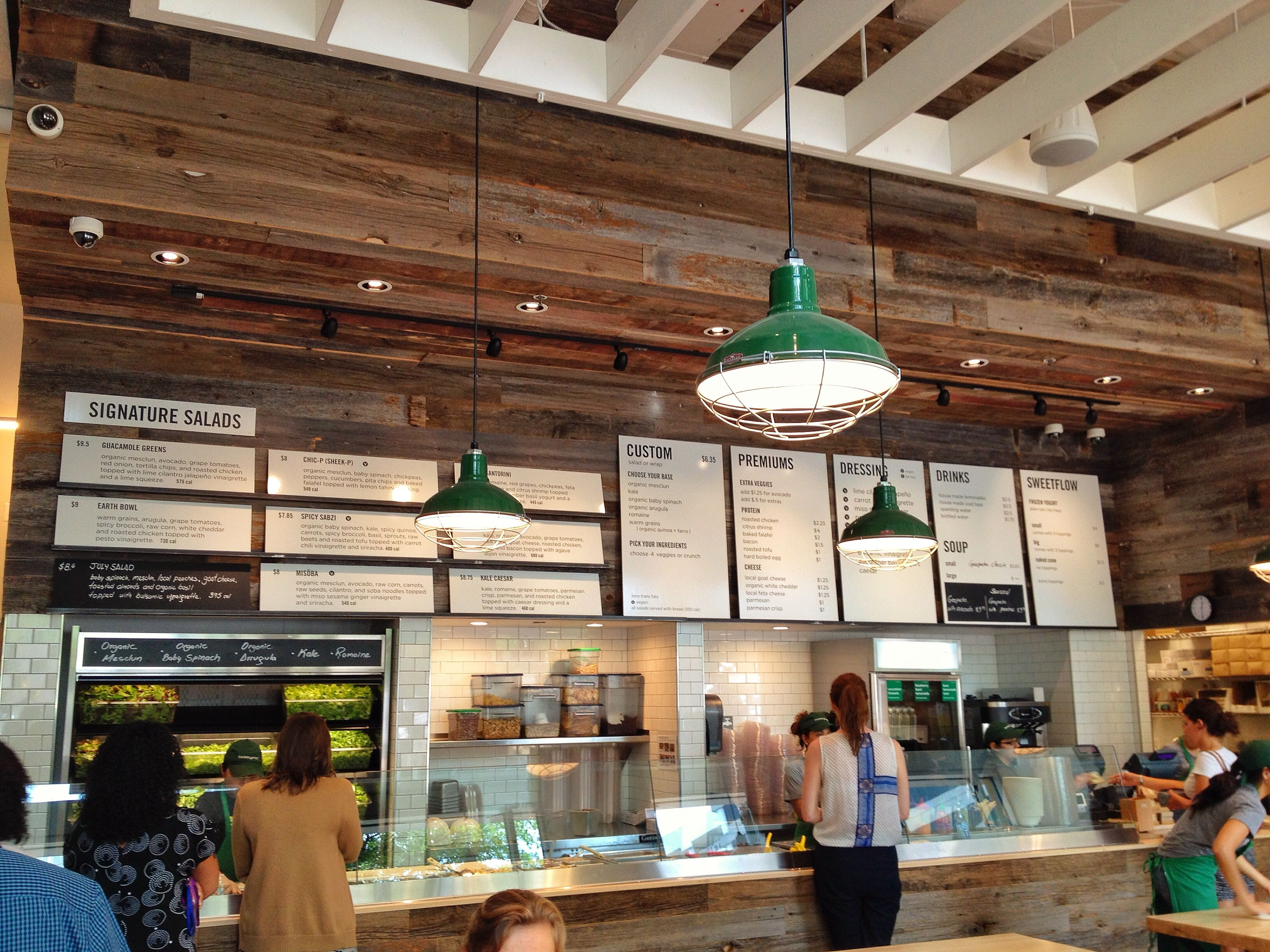 Sweetgreen floating shelves with leaning boards interior photo bar interior menu board design
