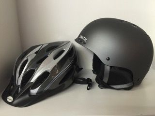 PAIR OF ADULT HELMETS INCLUDING SCHWINN AND SMITH SIZE LARGE SKATING OR BIKING HELMET.
