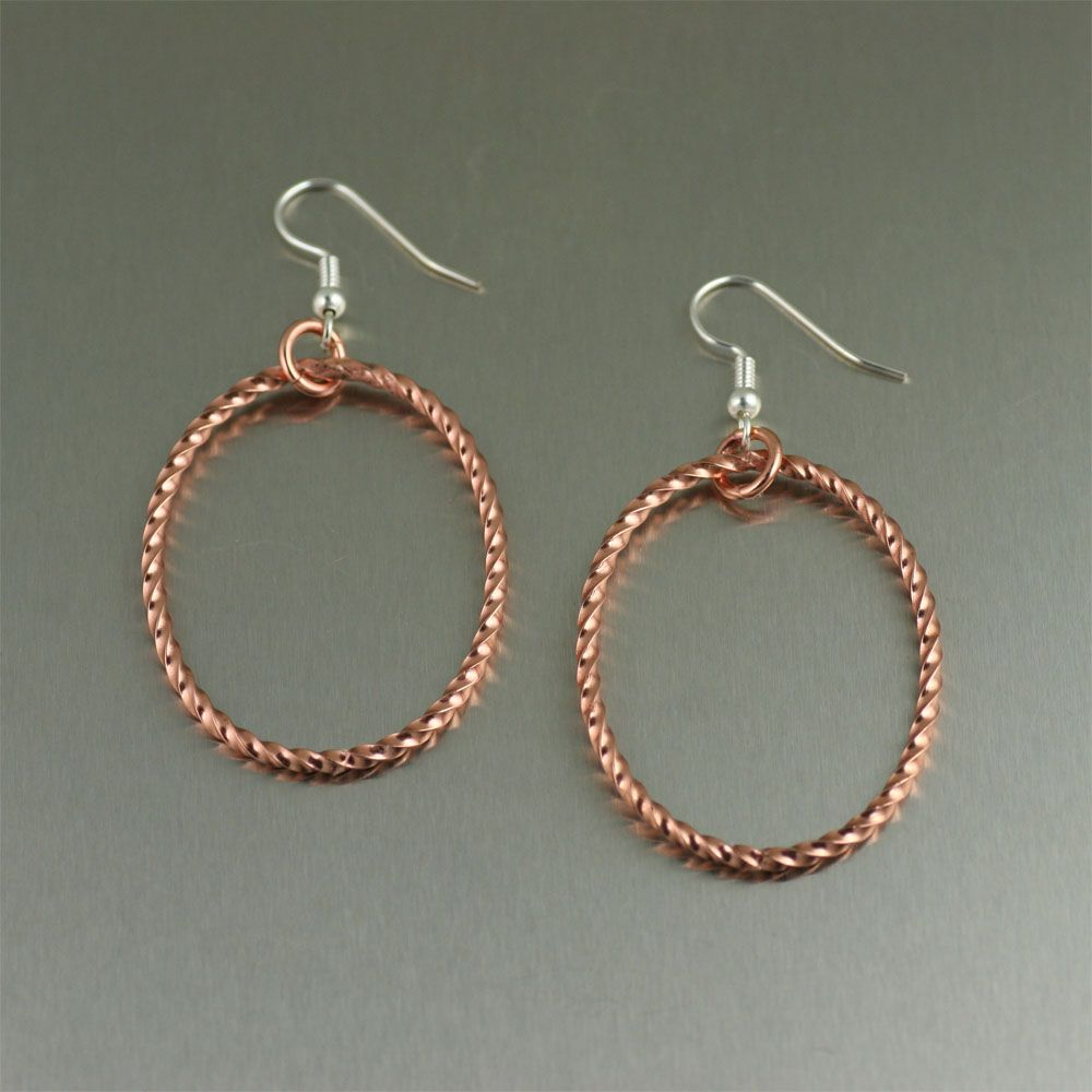 A twisted cable finish gives these hoop earrings a striking look. Exude sophistication and style when you wear these handmade oval Copper Hoop Earrings. Fashioned from pure copper, these earrings are sure to guarantee attention. #CopperEarrings