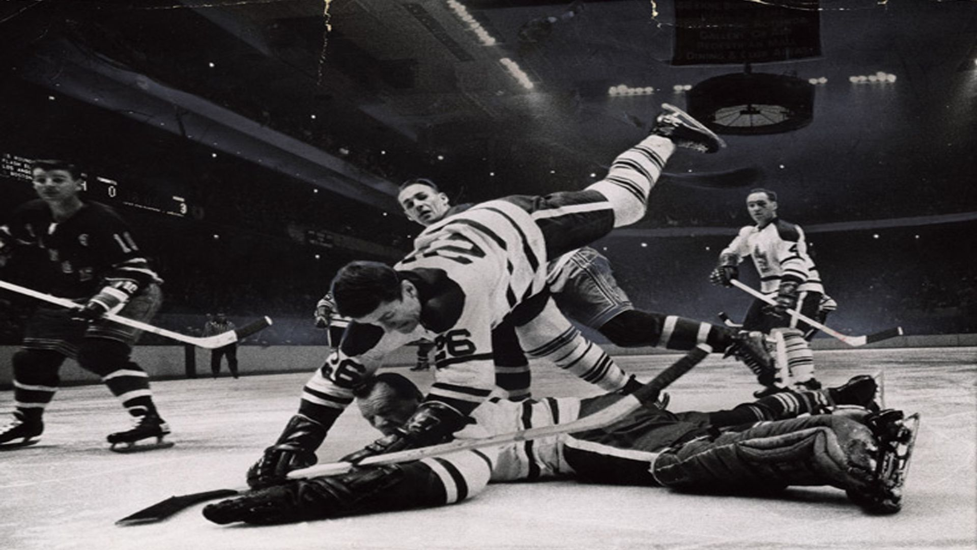 Alan Stanley tumbles over Johnny Bower as he crashes the