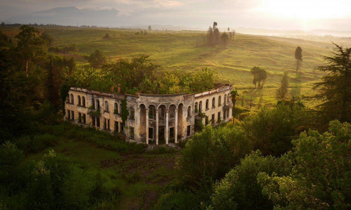 """A ruined college in Gali, Abkhazia, near the """"border"""" with Georgia, where ethnic Georgians made up 96% of the region's pre-war population. Most fled, or were driven out of their homes after the war. Today Gali is a twilight zone of empty buildings and overgrown farmland."""