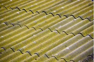 How To Use Corrugated Tin As A Backsplash In A Kitchen Hunker Corrugated Metal Roof Metal Roof Repair Tin Roof