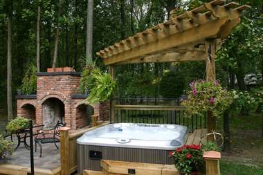 Backyard Oasis With Built In Barbecue And Hot Tub Hot Tub Garden Jacuzzi Hot Tub Inflatable Hot Tubs