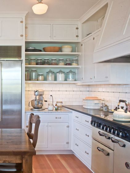 open cabinets with turquoise :: kitchen by seattle custom cabinets