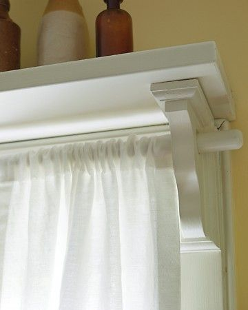 DIY curtain rods with shelf above.
