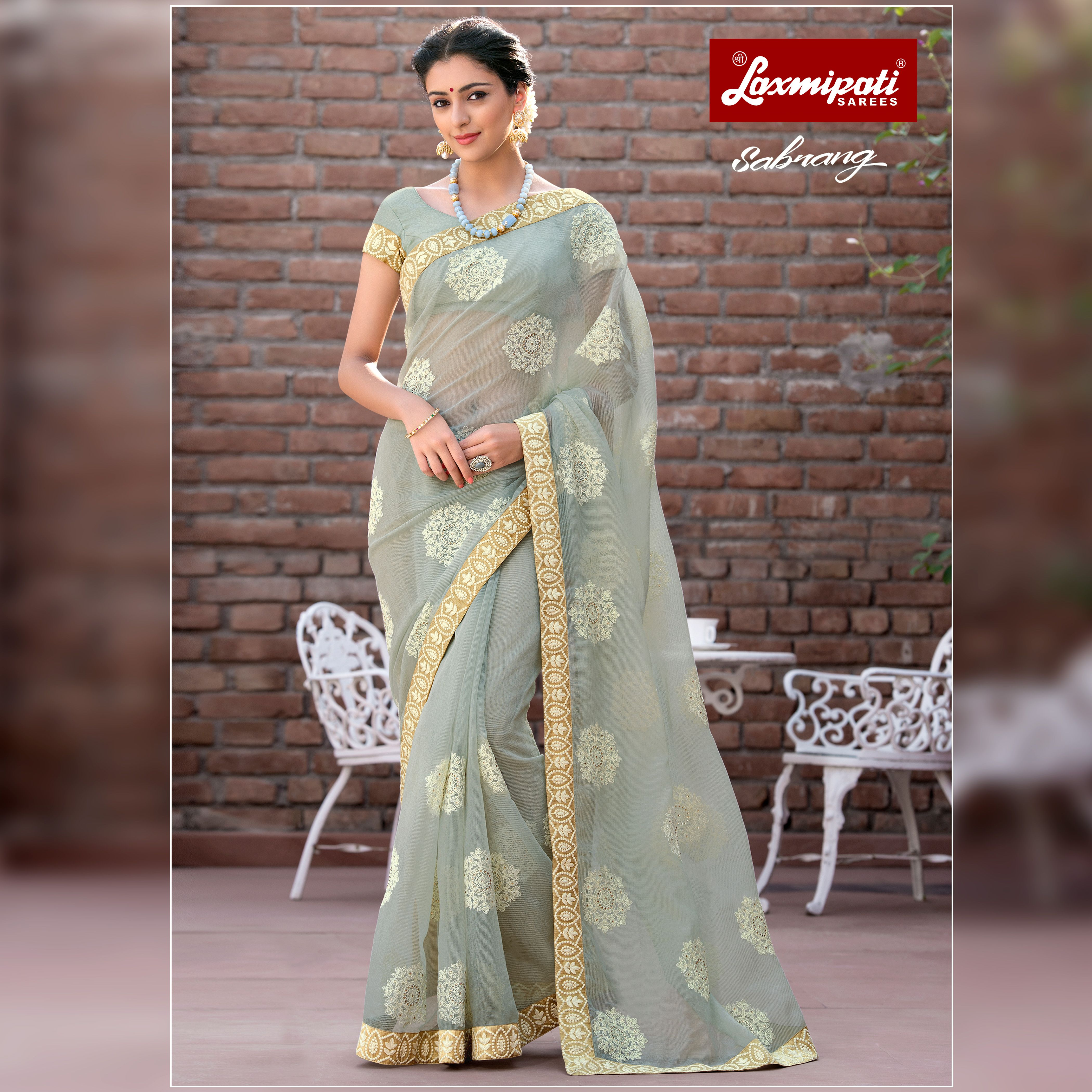 dfbe564a56 Explore the Laxmipati Grey Cotton Supernet Embroidered Saree and Grey  Rawsilk Blouse along with Lace Border for your special occasion.