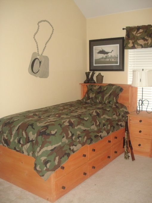 cute dog tags on wall, also boots on headboard   Favorite ...