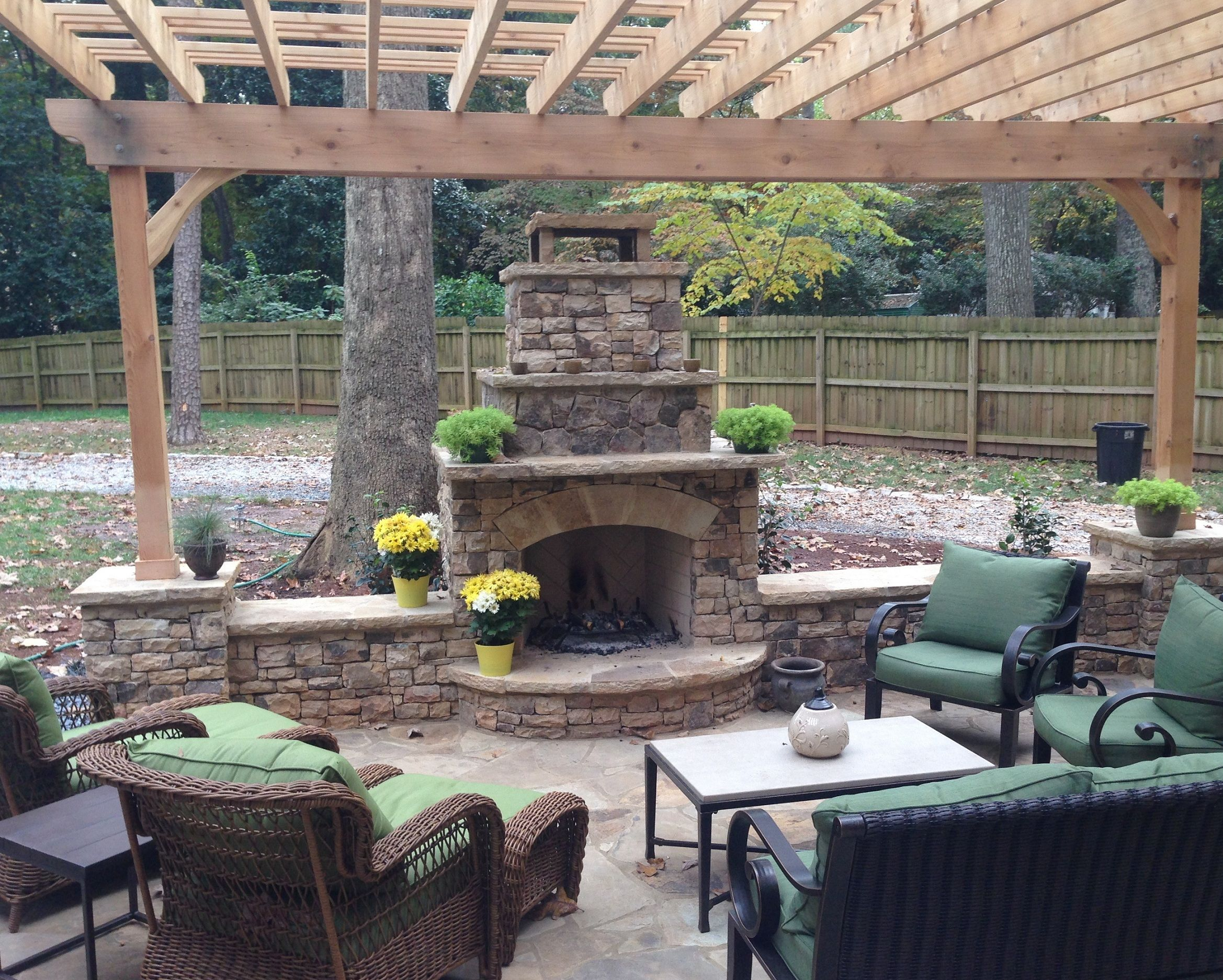 Patio with stacked stone fireplace in Atlanta, GA by Archadeck Outdoor Living