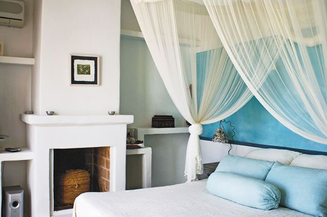 White and blue bedroom at Es Cucons boutique hotel, Ibiza.