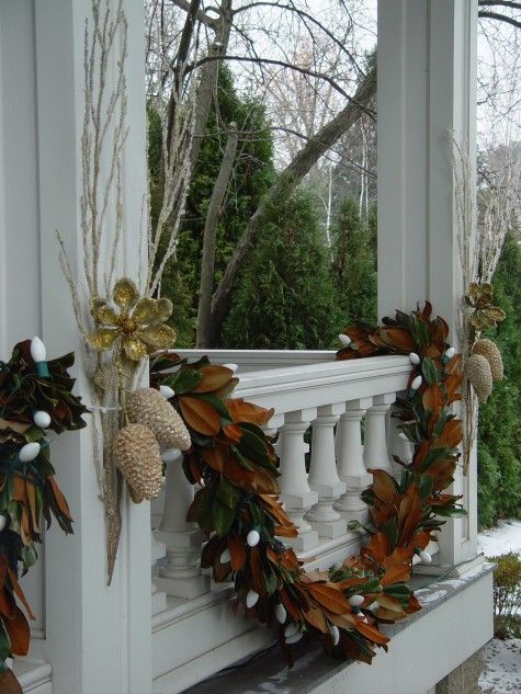 Magnolia leaf garland with large white lights christmas Outdoor christmas garland ideas
