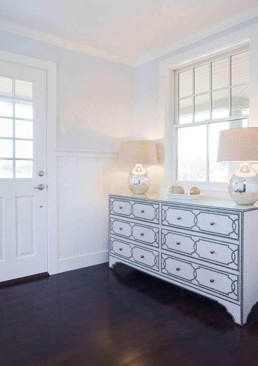 Lovely Foyer Features Blue Gray Paint On Top Half Of Walls And Vertical Paneling Bottom Framing Silver Nailhead Dresser Topped With Mercury