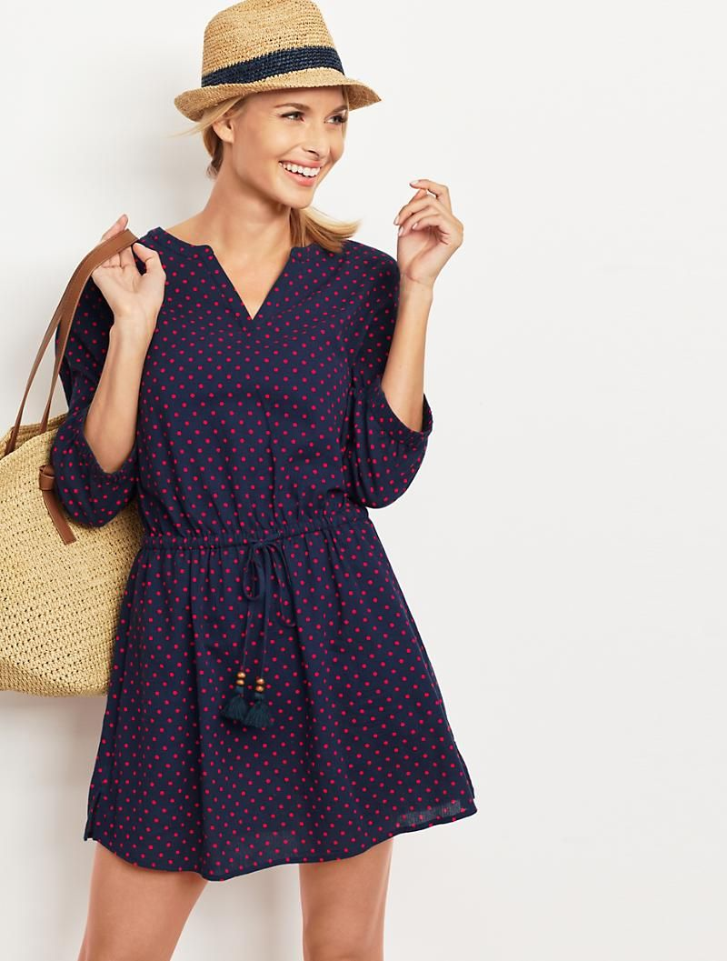 Light and airy in easy-to-wear crinkled cotton, this adorable polka-dot cover-up cinches at the elasticized waist to highlight the slenderest part of the frame and create a soft-yet flattering-skirt flare.