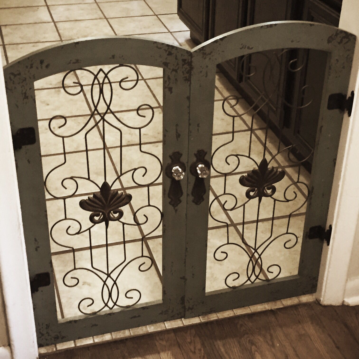 Two Hobby Lobby wall gates made into a dog gate | Living