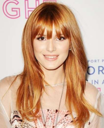 Disney darling Bella Thorne accented her strawberry blonde layers with a set of wispy bangs. - Jason LaVeris/FilmMagic