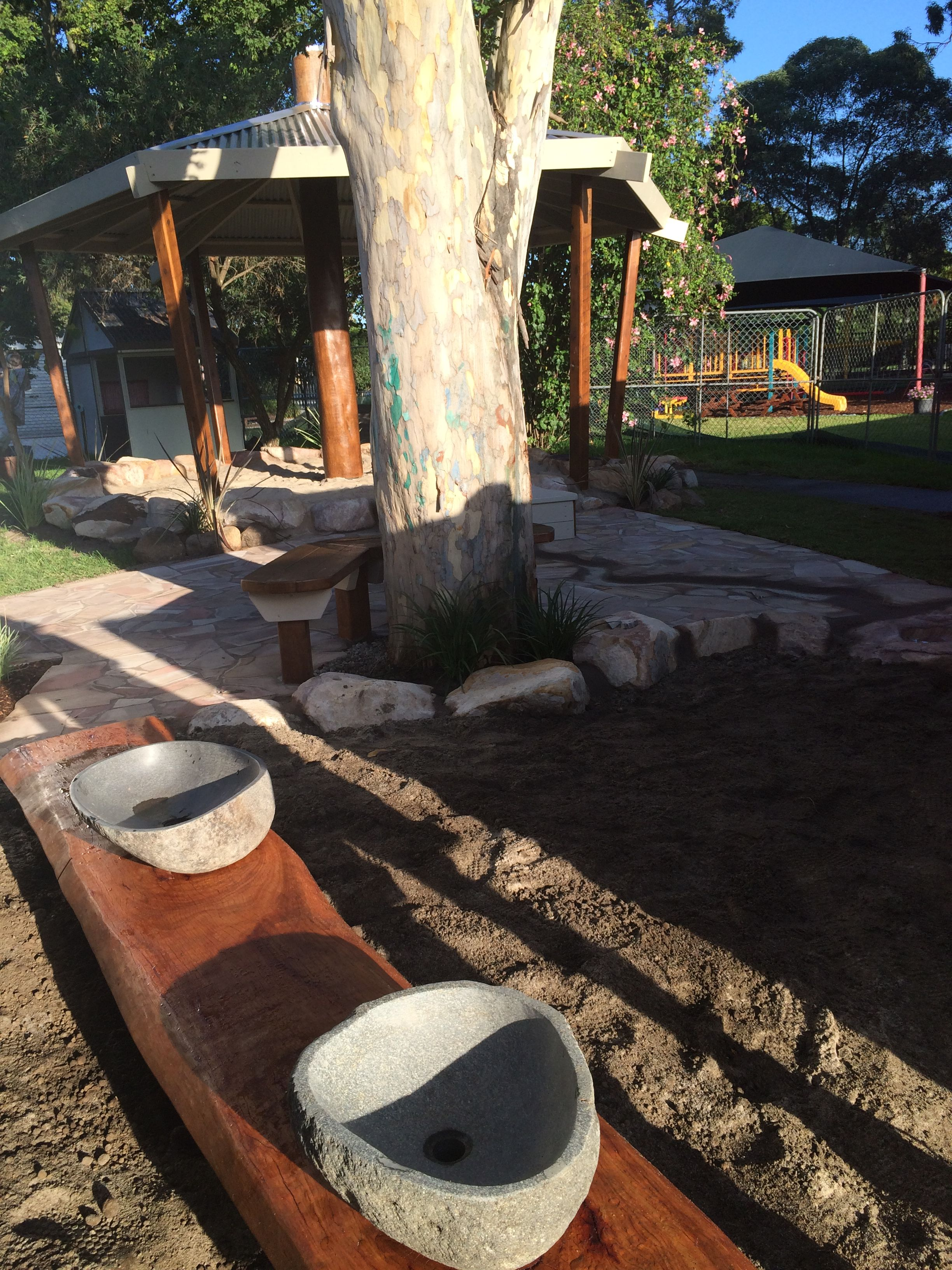 New mud pit and sandpit with water course and hand pump ...