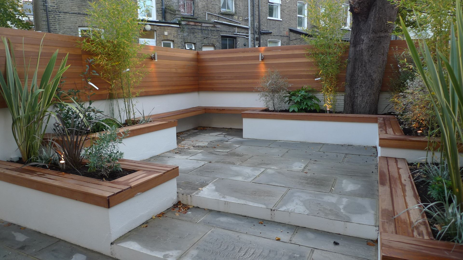 Grey indian sandstone patio paving london garden for Paving stone garden designs