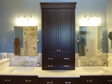 the master bath vanity wall features a stained wood linen