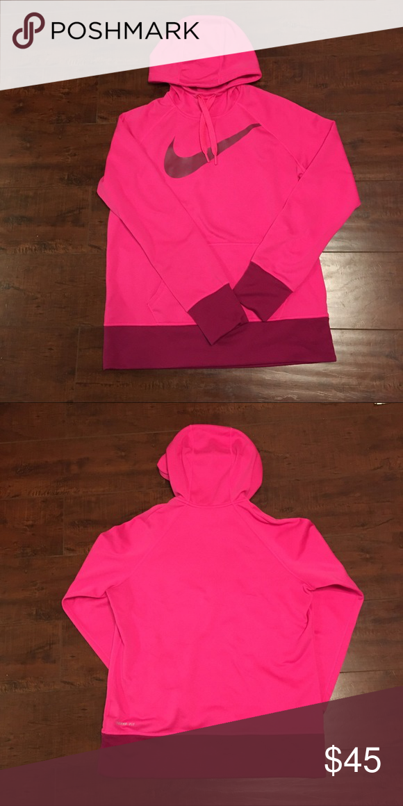 c25ed11241  Nike  Pink fuchsia pullover Hoodie Nike hoodie with very vibrant color pink    fuchsia. Worn a handful of times. Front hoodie pocket with drawstring  hood.
