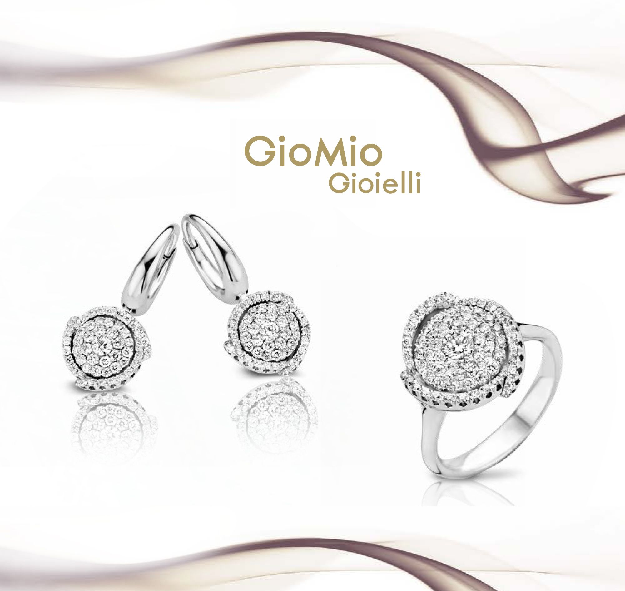 Golden earrings and ring with diamonds from our Collection Diamond