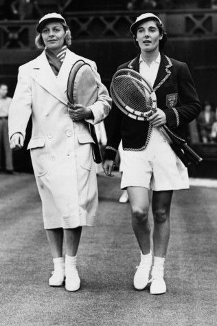 25th June 1938: American tennis player Alice Marble (left) and Kay Stammers walking on to court at Wimbledon.
