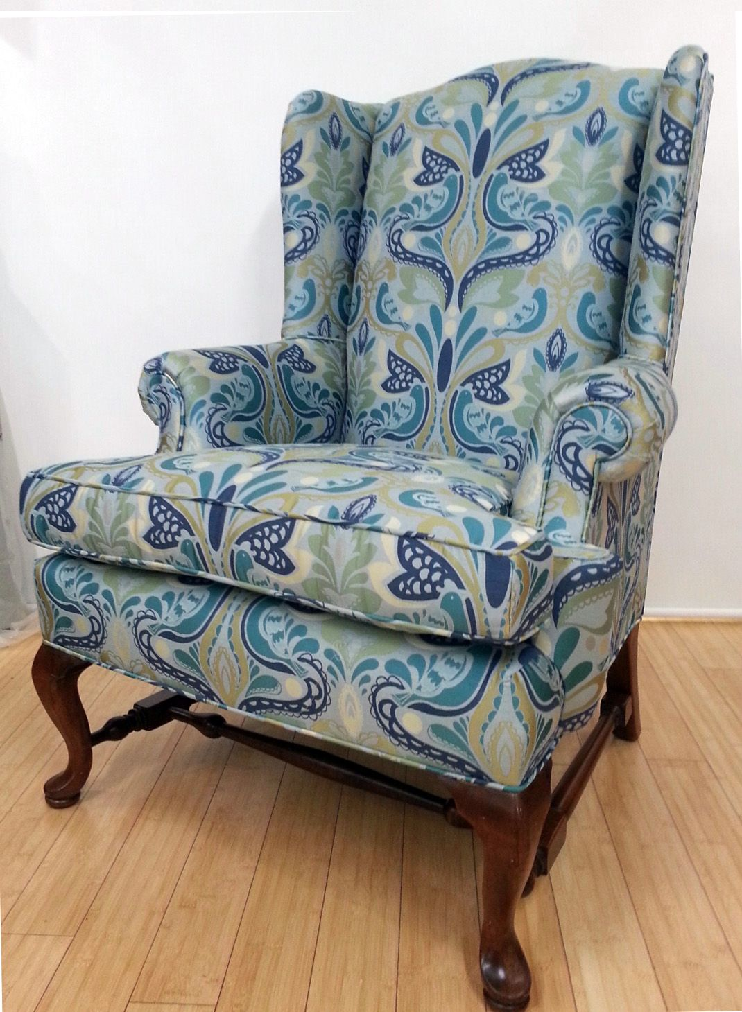 Reupholstered wing chair in floral bird print fabric from duralee fabrics upholster by blawnox upholstery