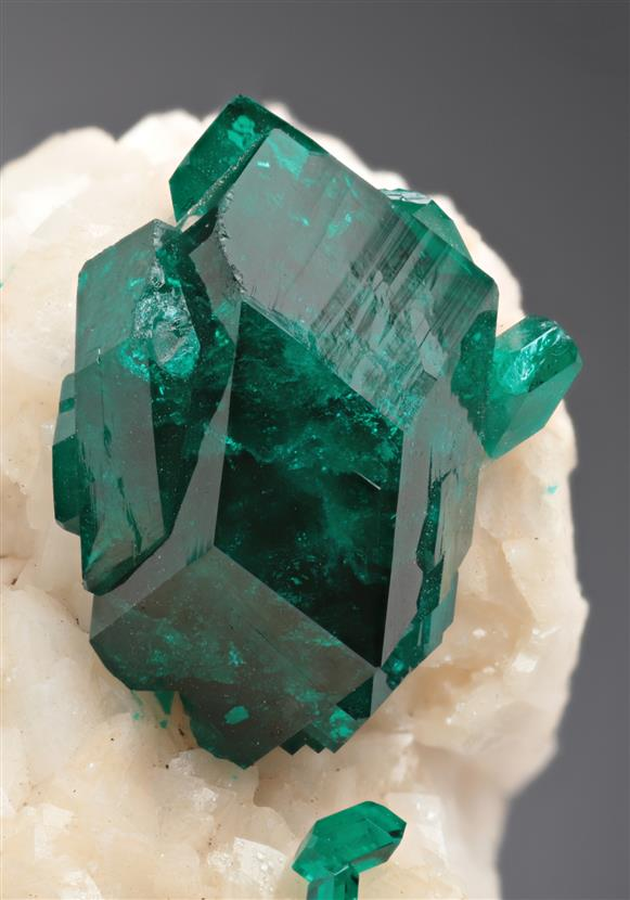A classic crystal specimen of Tsumeb Mine Dioptase on Dolomite. A major crystal on the specimen measures to a good 1.7 cm with great emerald green colour and lustre.