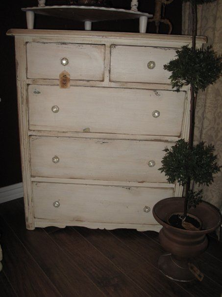 I found an old dresser in my garage and wasnt sure what to do with it. I think i shall sand it, paint it and then give it a distressed look like this!!!