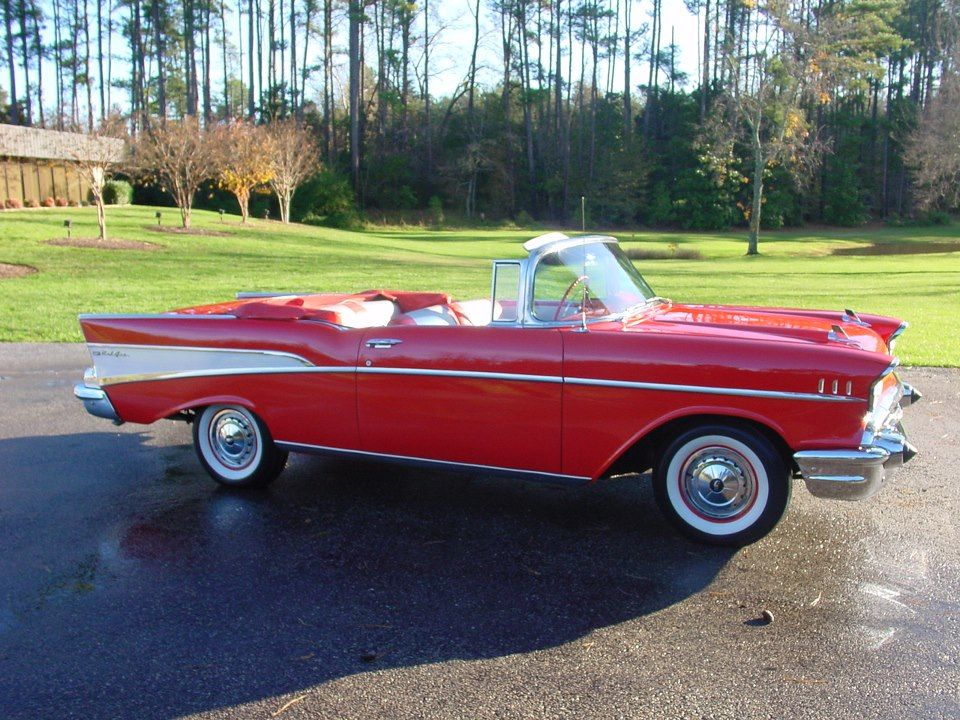 CHEVY BEL AIR: RARE 1957 red and white convertible with a 273 cid V8 and large white wall tires ... priceless!