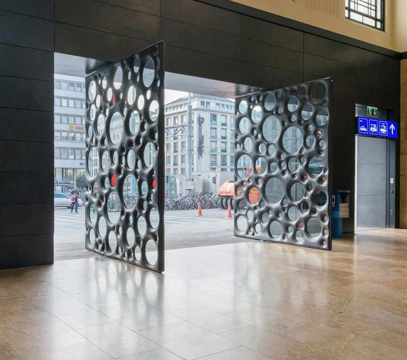 Sculptural Concrete Doors Welcome You To This Train Station In Geneva & Sculptural Concrete Doors Welcome You To This Train Station In ...
