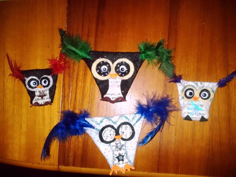 Fold Up Owls. I had these all over the Christmas tree last year.