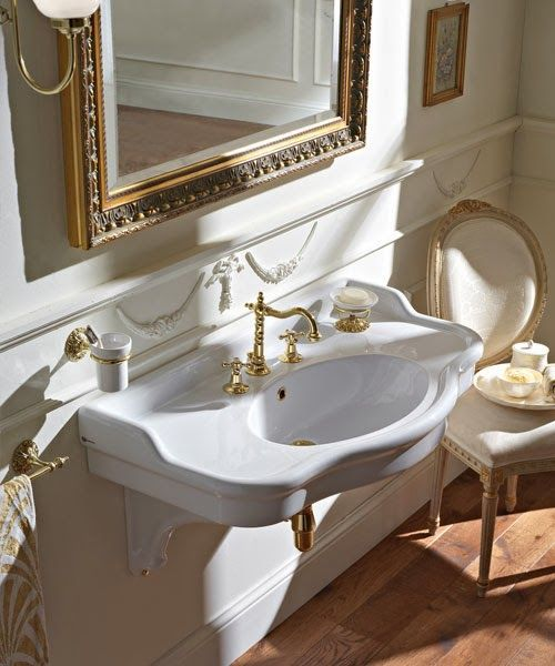 Traditional bathroom with mounted bathroom sink with gold fixtures