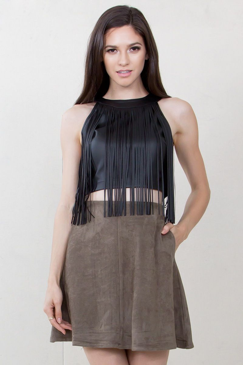3048c9f9815197 Black crop top with faux leather fringe tassels. Hidden zipper closure on  the back.