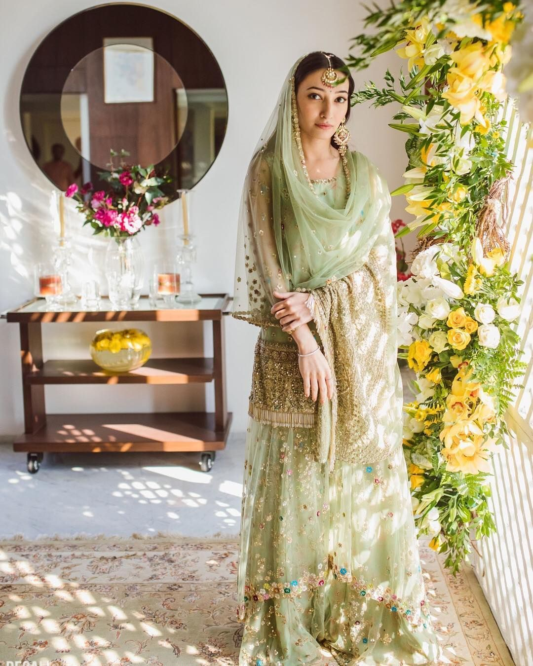 Bookmark These 25 Bridal Mehendi Lehengas Right Now! #shararadesigns This sharara design will surely mesmerise your eyes!!!  Tune in to our blog for more ideas!! #lehenga #lehengadesigns #sharara #bridallehenga #lehengas #eventila #latesttrends #trendyfashion #fashion #trendylehengadesigns #shararadesigns