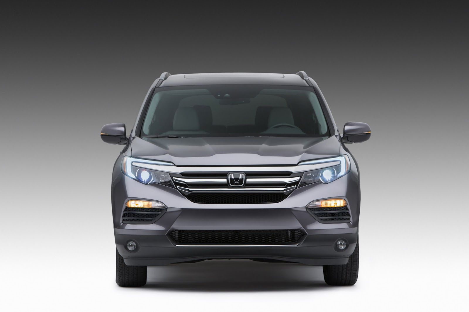 Honda has released the first photos of the new pilot suv capable of hauling 8 passengers the car was presented at the chicago auto show and will compete