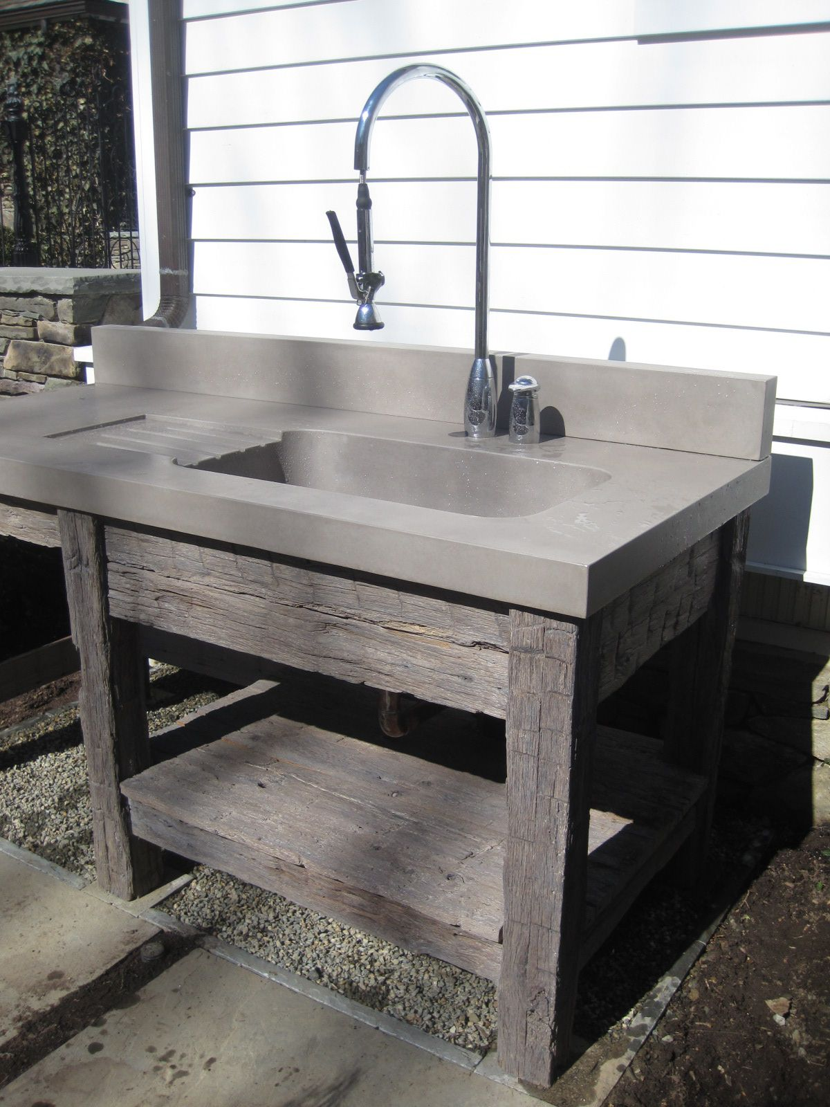 Reclaimed wood vanity base and concrete bathroom sink by Trueform ...