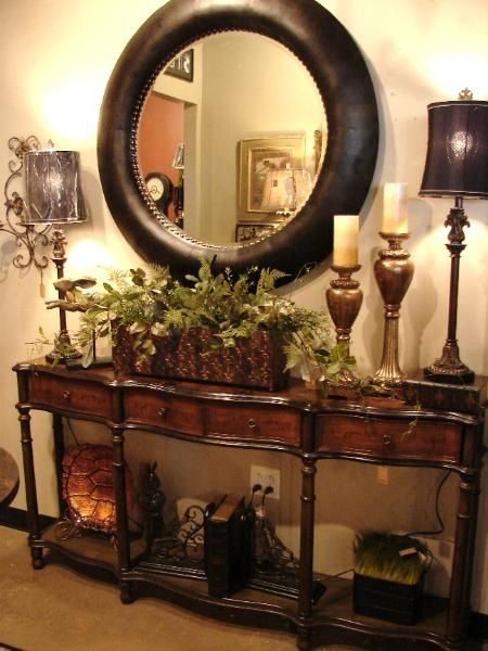 british colonial decor entry table with classic round mirror
