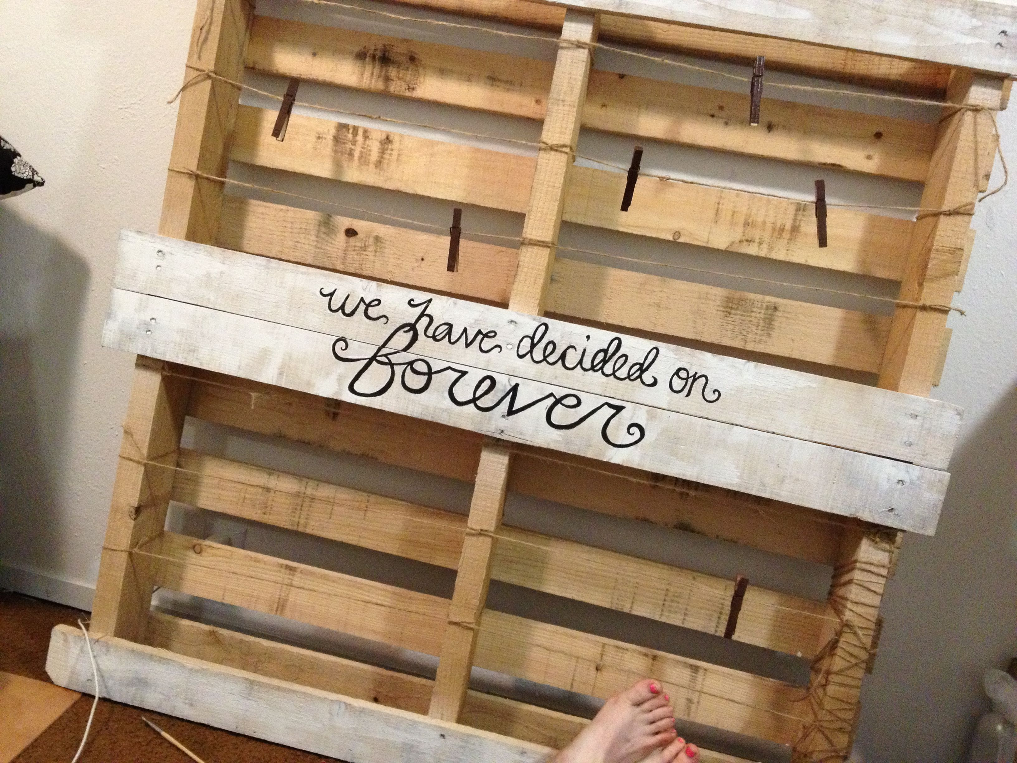 Pallet wedding decor ideas  Photo display made from an old pallet Using the backside and burlap