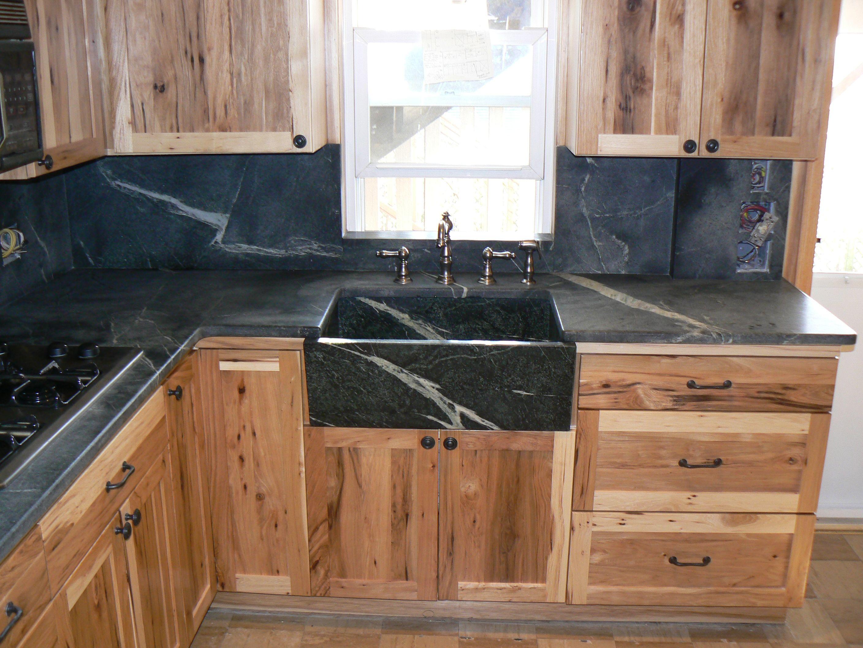 Marvelous unvarnished cedar kitchen cabinet system with dark