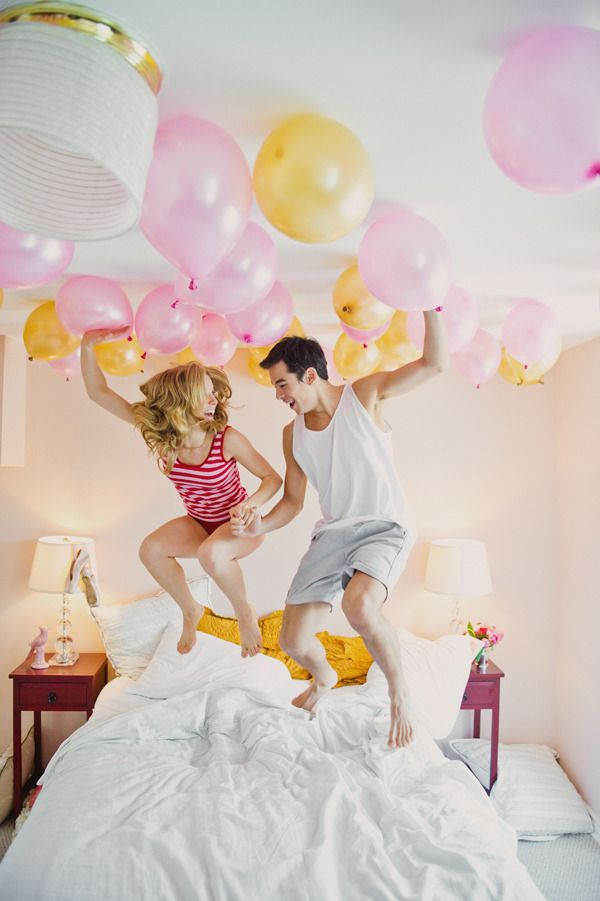 engagement on bed with balloons.