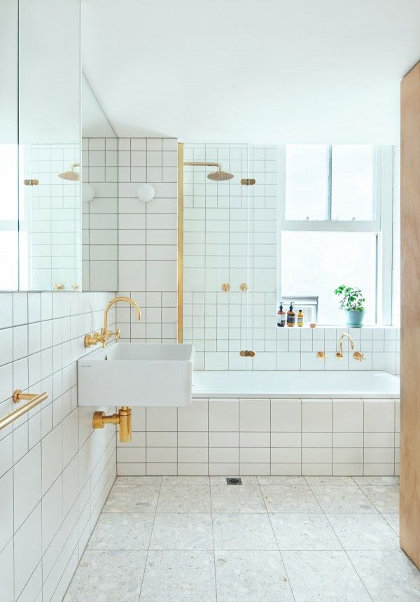 A Simple But Chic Bathroom Uses Clean White Tiles And Gold Plated Fixtures For Modern Minimal If Not Traditionally Anese Look