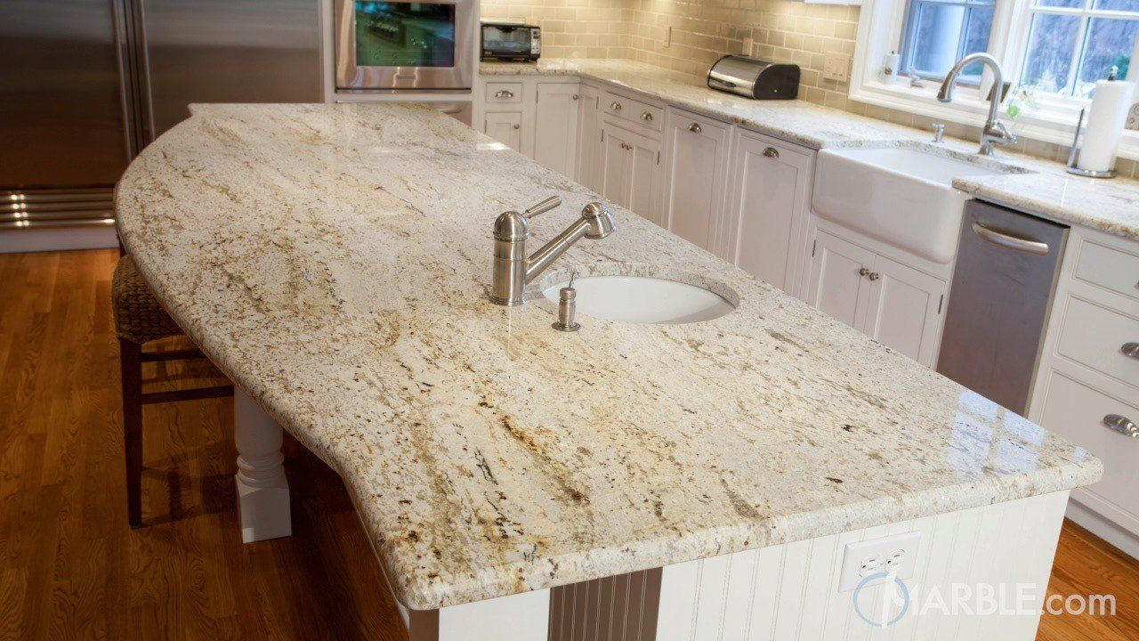 Colonial Gold Granite Looks Great In This Large Kitchen. The White  Countertop Matches Perfectly To