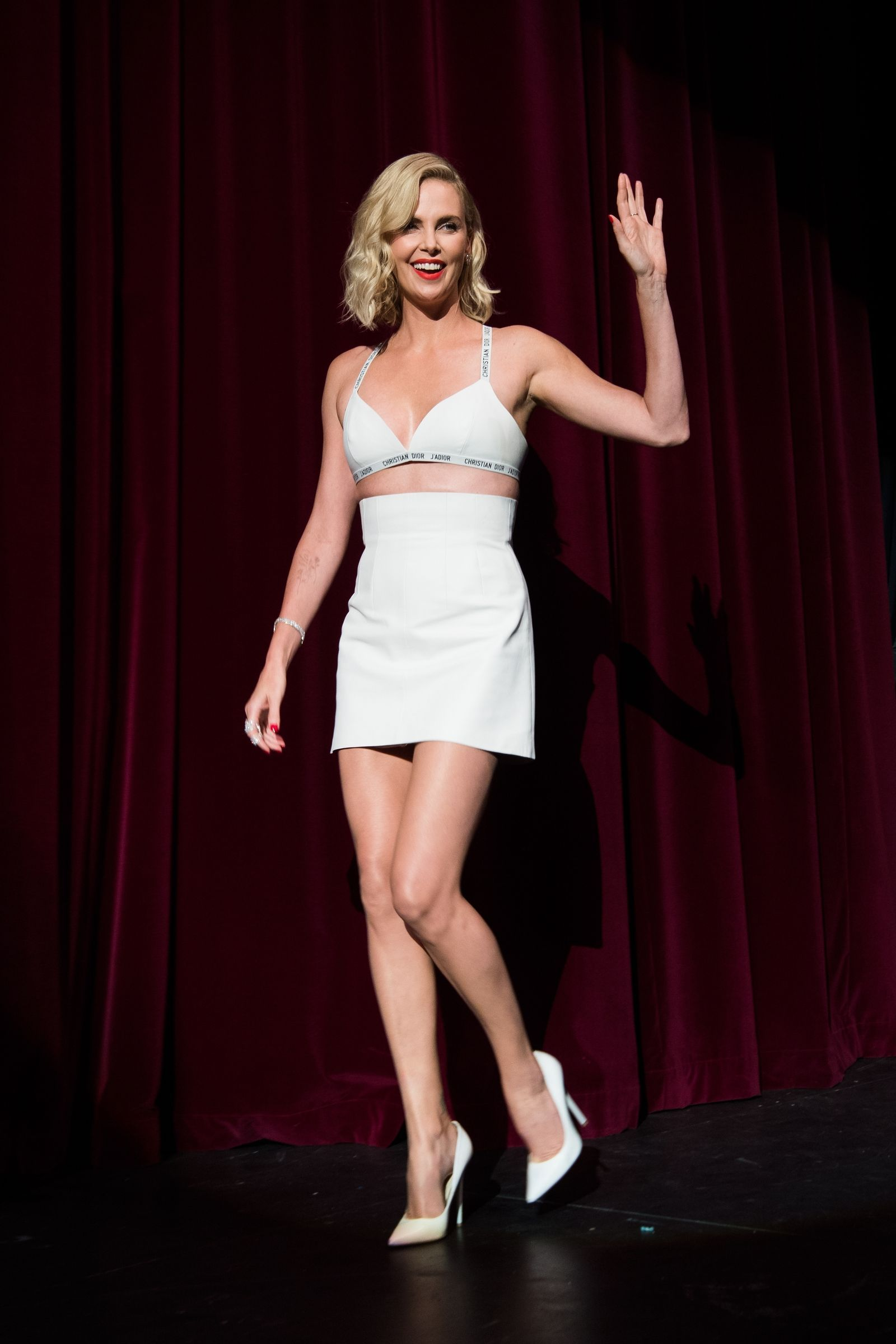 538ad0ee4f806 Charlize Theron Wore Nothing But A Dior Bra   Mini Skirt On The Red Carpet  - HarpersBAZAAR.com
