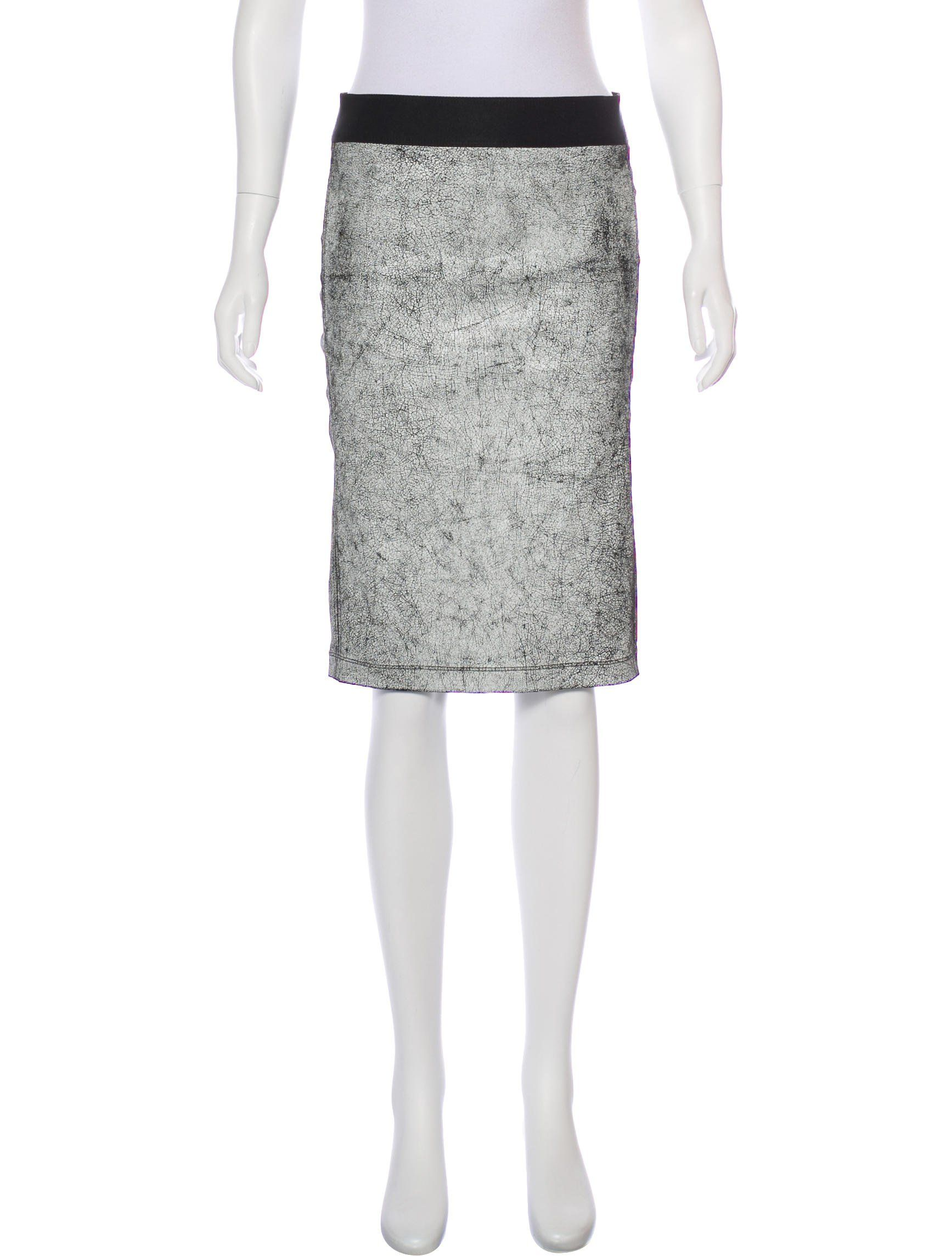 98703fd9ac Black and white Helmut Lang knee-length leather skirt with craquelure motif  throughout, slit accent at hem and elasticized waist.